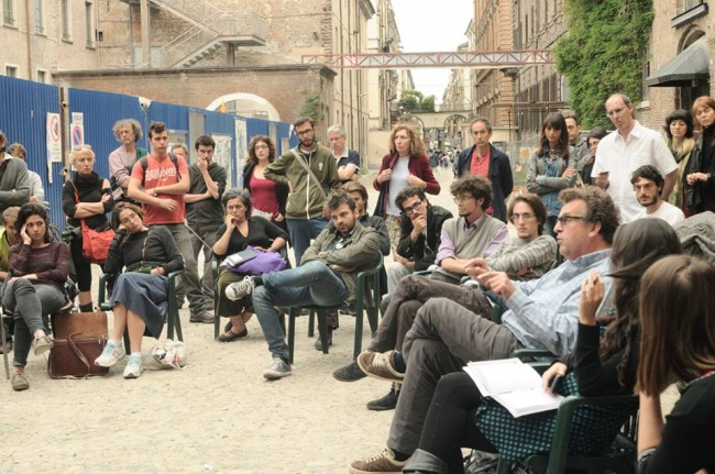 Gli occupanti di Assemblea Cavallerizza 14.45 (foto tratta da pagina facebook Cavallerizza 14.45)